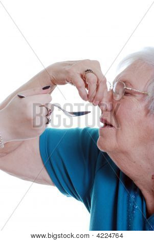 Elderly Woman Unhappy Taking Medication