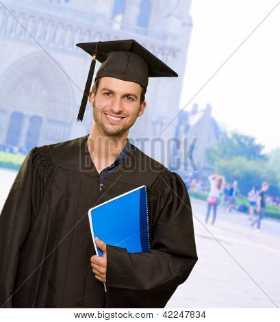 Happy Graduate Man Holding Book, Outdoors