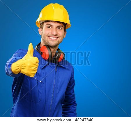 Engineer With Thumb Up Sign Isolated On Blue Background