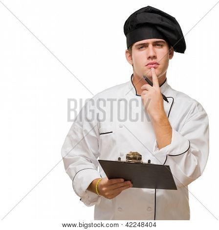 Young Chef With Writing Pad Thinking against a white background