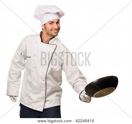 Portrait Of Male Chef Holding Pan Isolated On White Background