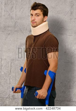 Disabled Man With Neck Brace Holding Euro Note, Indoors
