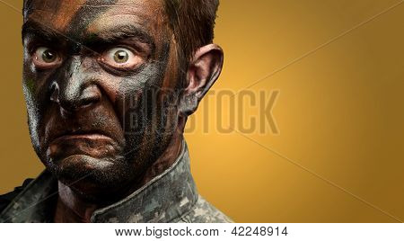 Close Up Of Angry Soldier Face against an orange background