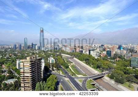 Skyline of downtown Santiago, the capital of Chile, featuring 300-meter high Gran Torre Santiago, the tallest skyscraper in Latin America, and Mapocho River, which divides the city in two parts.