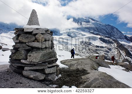 stoneman with group of tourists and beautiful glacial mountains - mount Hochfeiler - Zillerttal Alps