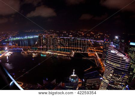 SINGAPORE, FEBRUARY 12 - Wide angle night time aerial view of Singapore city skyline including the Singapore Flyer and the Marina Bay Sands hotel along the Singapore river on Feb 12, 2013 Singapore.