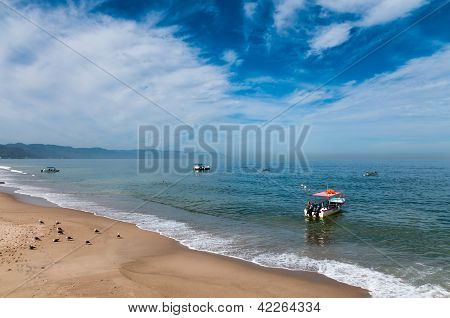 Boats And Seabirds At The Beach