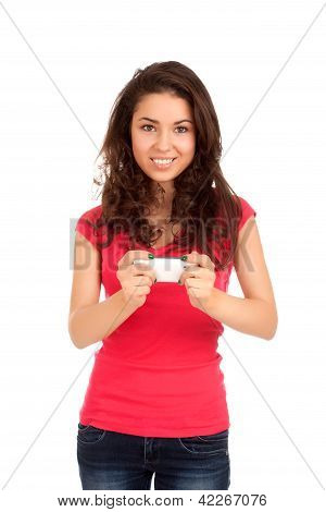 Young woman playing games on smartphone