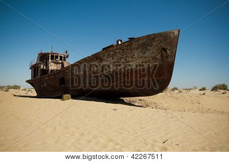 Rusting Boats In The Desert