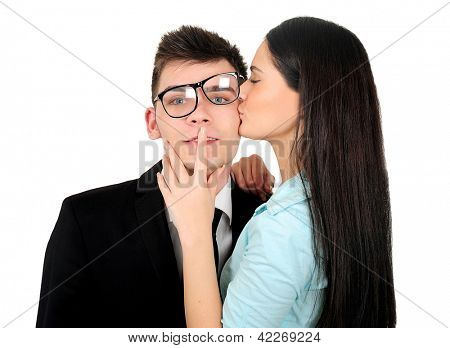 Isolated young business couple kissing