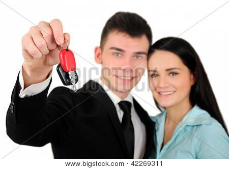 Isolated young business couple with car key