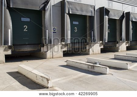 Loading bay for trucks with numbers in sunny day