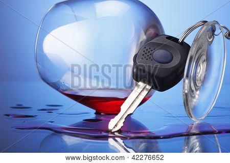 car key hanging at wine glass