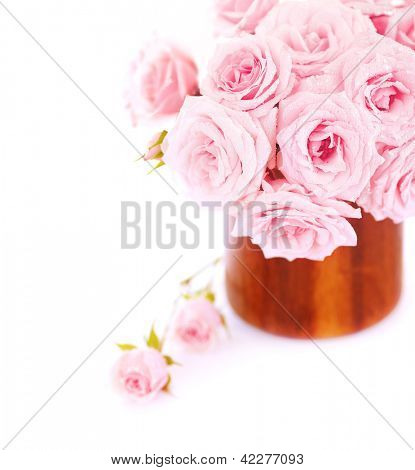 Picture of great rose bouquet in wooden pot isolated on white background, pink bridal bunch in vase in studio, romantic holiday gift, wedding day, mothers day, spring season, romance and love concept