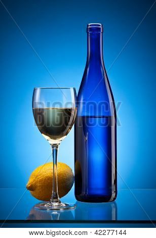 Blue Wine Bottle And Lemon
