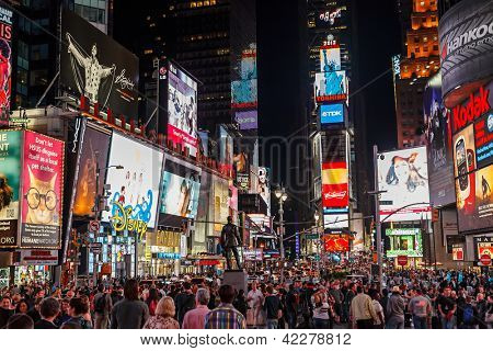 NEW YORK - APRIL 17, 2012: Night traffic across Times square on April 17,2012 in New York City. Times Square is the most visited tourist attraction in the world with over 39 million visitors annually.