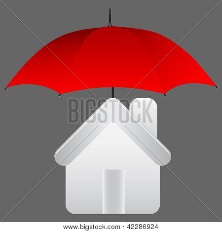 在伞下的房子.保险的概念.