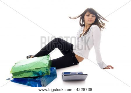 Girl, Notebook And Two Shopping Bags