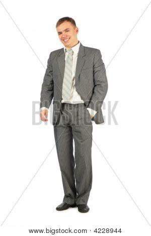 Lachend Mann im Anzug Stand auf einem weißen Hintergrund