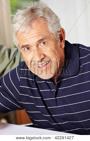 Portrait of a happy smiling elderly man in a retirement home