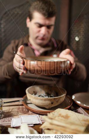 Man Holds Plate Of Khash