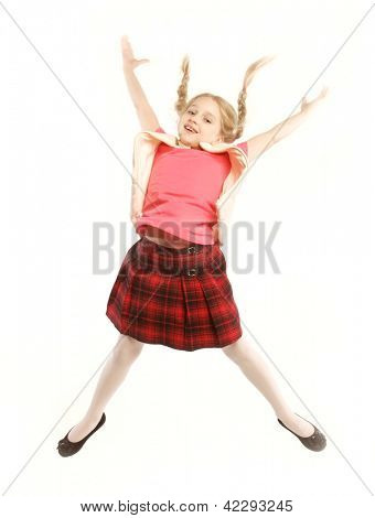happy girl jumps on a white background