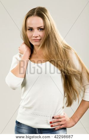 glamorous young woman in a white blouse