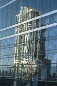 Glass Reflection Of Building poster