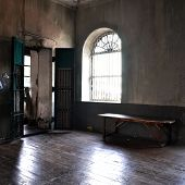 stock photo of discard  - Abandoned empty room with door window and bench - JPG