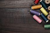 image of rayon  - threads on the brown wooden table background - JPG