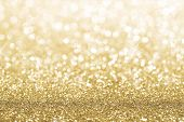 image of gold-dust  - Gold defocused glitter background with copy space - JPG