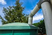 stock photo of groundwater  - big green rainwater recuperator in a garden - JPG