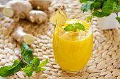 stock photo of mango  - Fresh mango with ginger smoothie by fresh ingredients - JPG