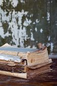 image of annal  - Vintage books on a wooden surface sepia