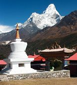 stock photo of nepali  - Stupa in Tengboche monastery with mount Ama Dablam on the way to Everest base camp - JPG