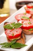 Bruschetta Topped With Fresh Tomato And Basil