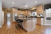 image of granite  - Kitchen in luxury home with oak wood cabinetry - JPG