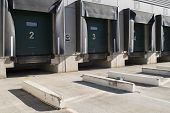 stock photo of loading dock  - Loading bay for trucks with numbers in sunny day - JPG