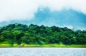 Image of Costa Rica, nature of Central America, fog in the mountains, green forest near river, beaut