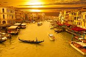 stock photo of gondolier  - Sunset of grand canal in venice with gondolas - JPG