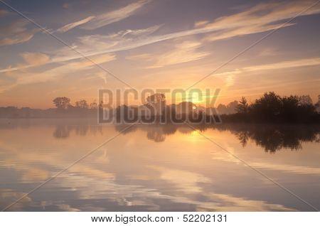 Calm Misty Sunrise Over Wild Lake