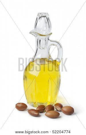 Moroccan cosmetic Argan oil and nuts on white background