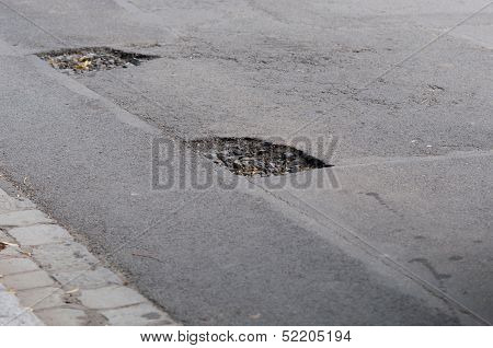 Dangerous Pothole On A Road