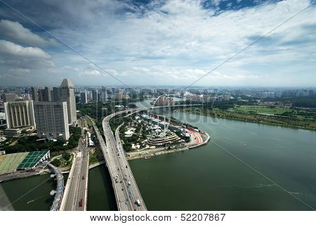 SINGAPORE - SEPTEMBER 16: An aerial view of Singapore river and coast line, buildings and highways on September 16, 2013 in Singapore. Singapore is South East Asia's financial capital.