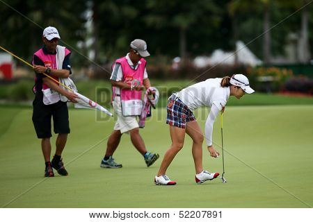 KUALA LUMPUR - OCTOBER 12: So Yeon Ryu of South Korea collects her ball from the 2nd hole of the KLGCC course on Day 3 of the Sime Darby LPGA on October 12, 2013 in Kuala Lumpur, Malaysia.