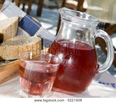 Home Made Rose Wine And Crusty Bread At Greek Island Taverna