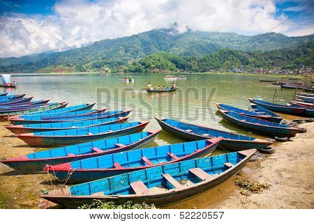POKHARA,NEPAL-MAY 25: Floating is a major tourist attraction on Fewa (Phewa) lake in Pokhara, Nepal on May 25, 2013. One of the most beautiful Lakes of Pokhara Valley is the well-known Phewa Lake.