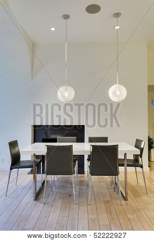 A white dining table in a modern house