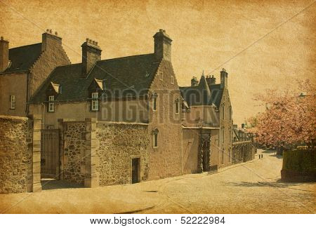 One of  Stirling sreet in spring day, Scotland, UK . Photo in retro style. Paper texture.