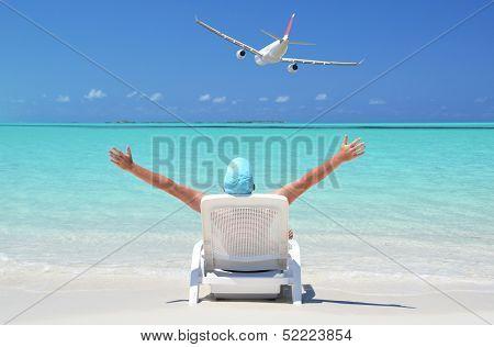 A  man sunbathing on the beach of Great Exuma, Bahamas
